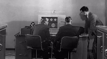 Turing (right) at the console of the Mark II computer (Courtesy of the University of Manchester School of Computer Science)