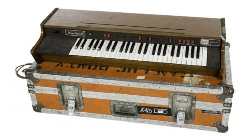 "An Arp PE4 Electronic Music String Ensemble synthesizer in an orange Anvil road case stenciled ""K-40 ICA tag 591 Jean-Luc Ponty."""