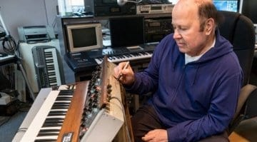 Jan Hammer signing the Model D Minimoog