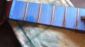 Masked fretboard