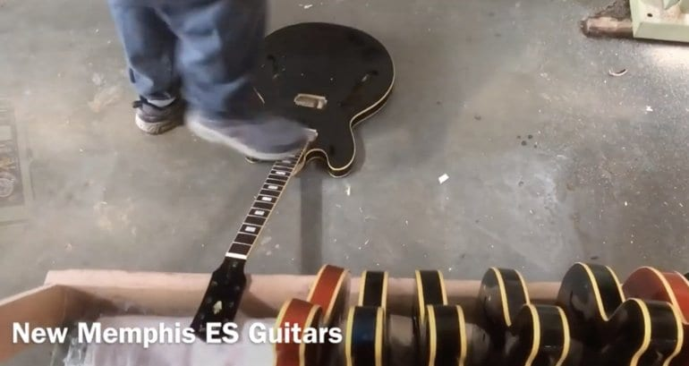 Gibson ES Guitar getting stomped on