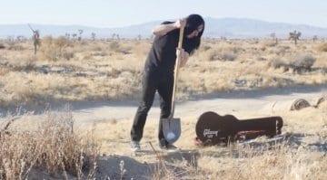 Man buries guitar in desert