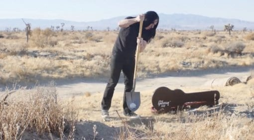 Man buries guitar in desert