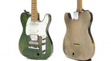 Francis Rossi's battered Status Quo Fender Telecaster sells at auction