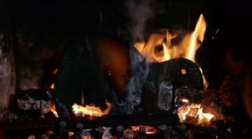 Relaxing Yuletide log? - Hold on, that's a guitar in flames!