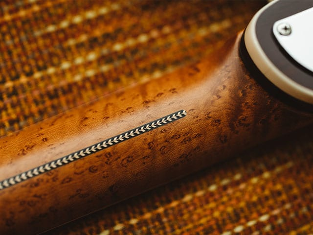 Roasted figured maple neck accented with a decorative herringbone inlay