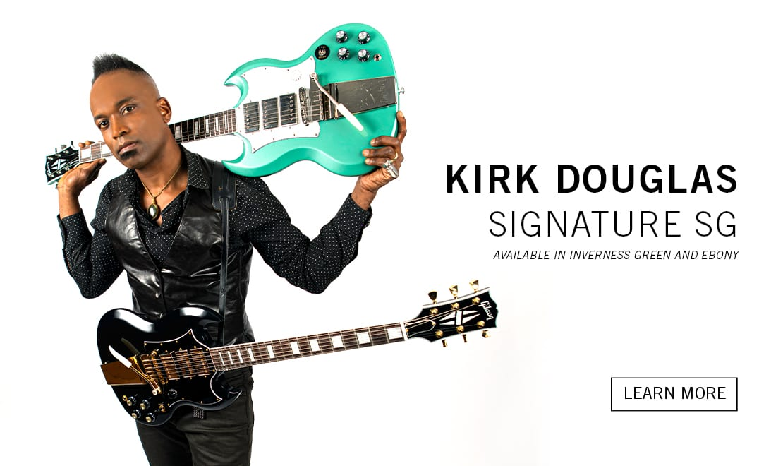 Kirk Douglas with sis new signature Gibson SGs