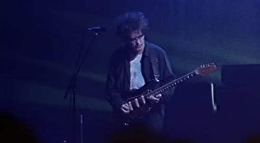 Robert Smith live in 1992 with his Fender Bass VI