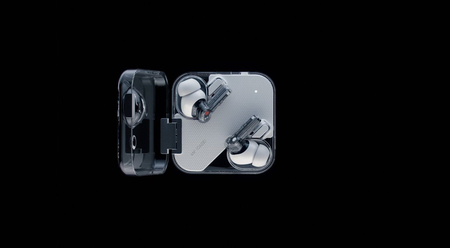 Ear (1) in their transparent charging case.